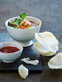 Asian soup with prawns, a dip and prawn crackers