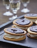Sandwich biscuits filled with cream and topped with chocolate glaze