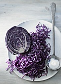 Red cabbage, halved and grated, and a spoonful of salt