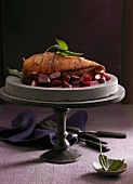 Goose breast on a bed of beetroot