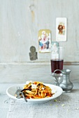 Linguine with aubergines, tinned tomatoes and goat's cream cheese