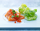 Smoked salmon with chum salmon caviar and lettuce leaves