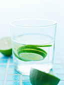 Slices of lime in a glass of water