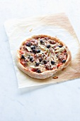 Salsiccia and black olive pizza