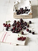 Cherries, a tea towel and a wooden crate