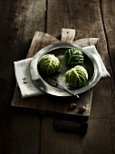 Savoy cabbage balls with cream and nutmeg