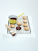 Gingerbread biscuits topped with chocolate glaze on a wire rack