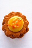 A biscuit topped with exotic orange curd