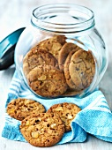 Ginger and chilli biscuits on a tea towel and in a jar