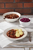 Beef ragout with beer from Salzburg with potato dumplings and red cabbage