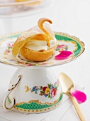 A choux pastry swan (close-up)