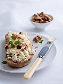 Bread topped with ricotta and roasted nuts