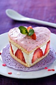 A heart-shaped strawberry cake