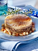 Lamb and coconut cake with tomatoes and beans (Brittany)