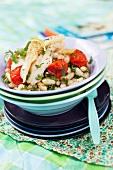 Fish fillet on bean salad with parsley and tomatoes