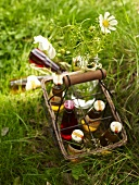 Italian herbal lemonade in a wire bottle basket on the grass