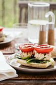 Chicken burger with fried tomatoes