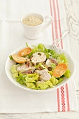 Caesar salad with chicken, capers and anchovies