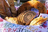 Herb bread and wholemeal rolls in a bread basket