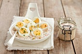 Boiled eggs in horseradish sauce with turnips, dill and beansprouts
