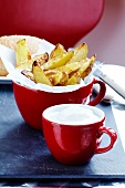 Baked potato wedges and sour cream