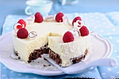 Mango and coconut cake with raspberries, sliced