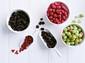 Various berries in bowls, seen from above