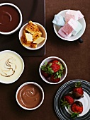 Chocolate fondue with strawberries, cake and marshmallows