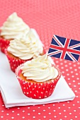 Three cupcakes and a small flag