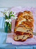 A bread plait with raisins and slivered almonds for Easter