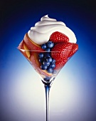 Fresh Fruit Salad in a Stem Glass Topped with Whipped Cream