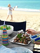 Grilled lamb chops with mint sauce on the beach