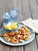 Grilled prawns with lemon wedges