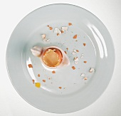 The remains of a boiled egg on a plate