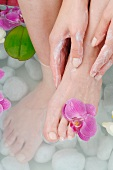 Woman taking foot bath