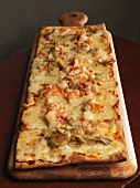 Long Rectangular Pizza on a Cutting Board
