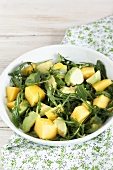 Rocket salad with avocado and mango