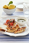 Grilled chicken breast with a herb sauce