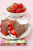 Chocolate pancakes with vanilla quark and strawberries