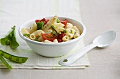 Pasta salad with asparagus, tomatoes and peas