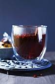 Punch with berries and a cinnamon stick