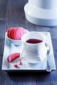 Fruit tea with raspberry biscuits