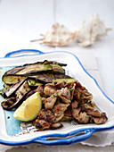Crispy fried chicken meat with aubergines