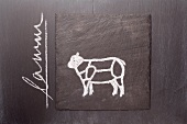 A sketch of a lamb on a chalkboard