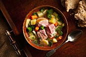 A Bowl of Vegetable Soup with Pieces of Pork