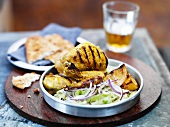 Tandoori partridge with a side salad