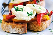 Bruschetta peperone e caprino (toasted bread topped with pepper and cheese)