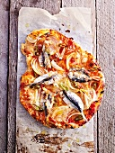 A sardine, onion and chilli pizza