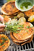 Grilled pita breads with chermoula and basil oil