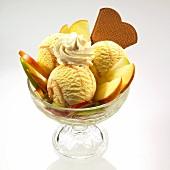 An apple ice cream sundae with cream and wafers